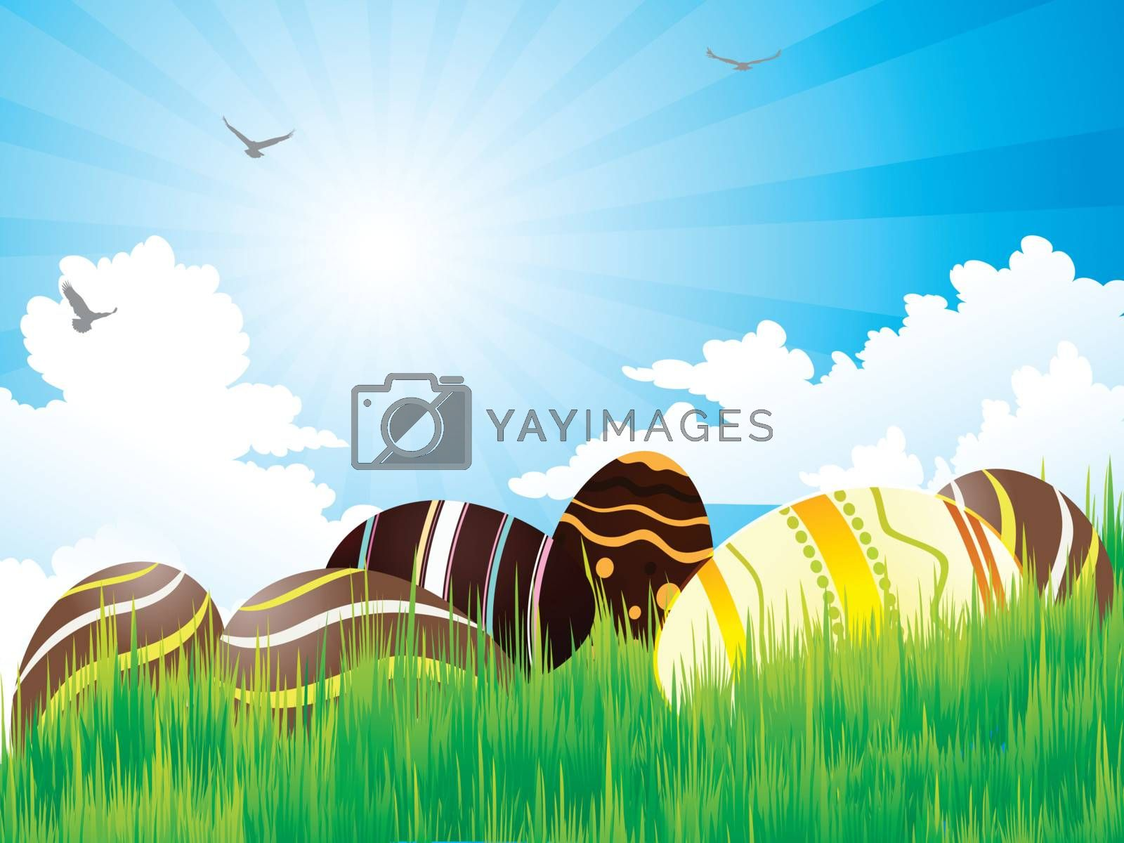 Easter eggs on green grass and bright sky