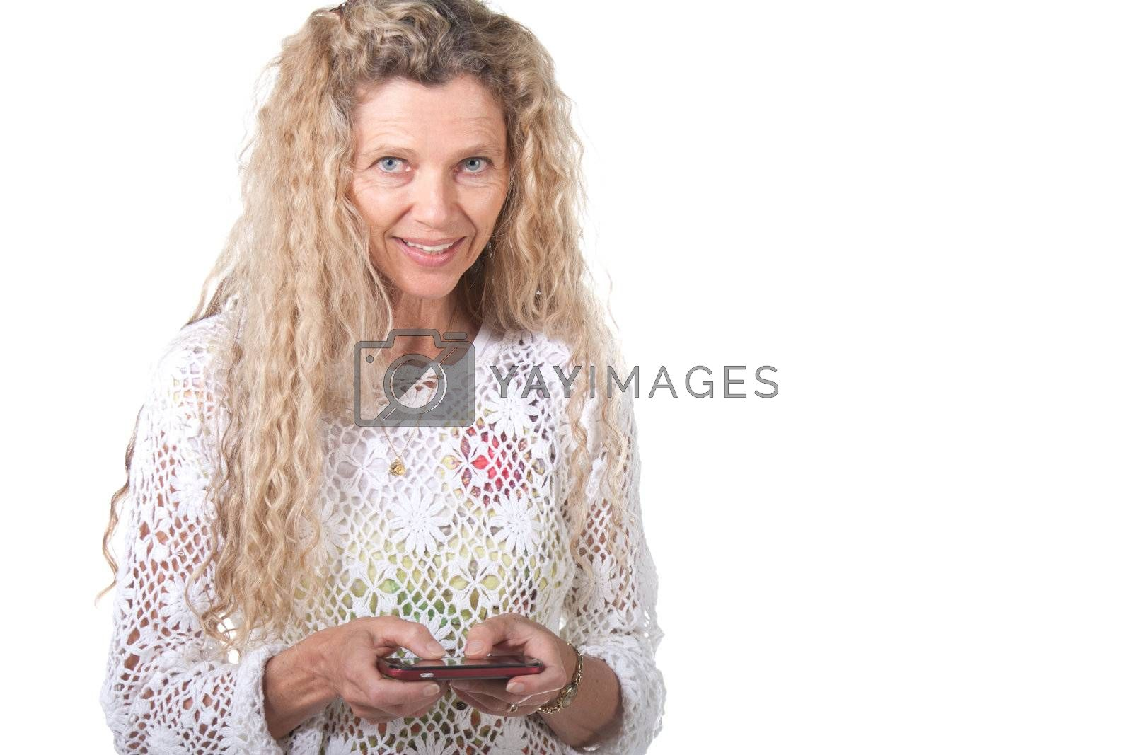 mature woman texting on smart cell phone