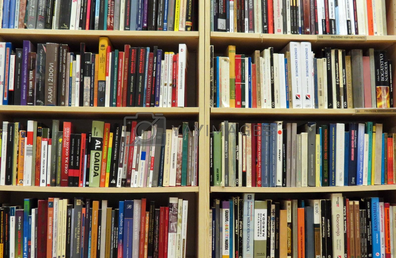 Bookshelf in library with many books