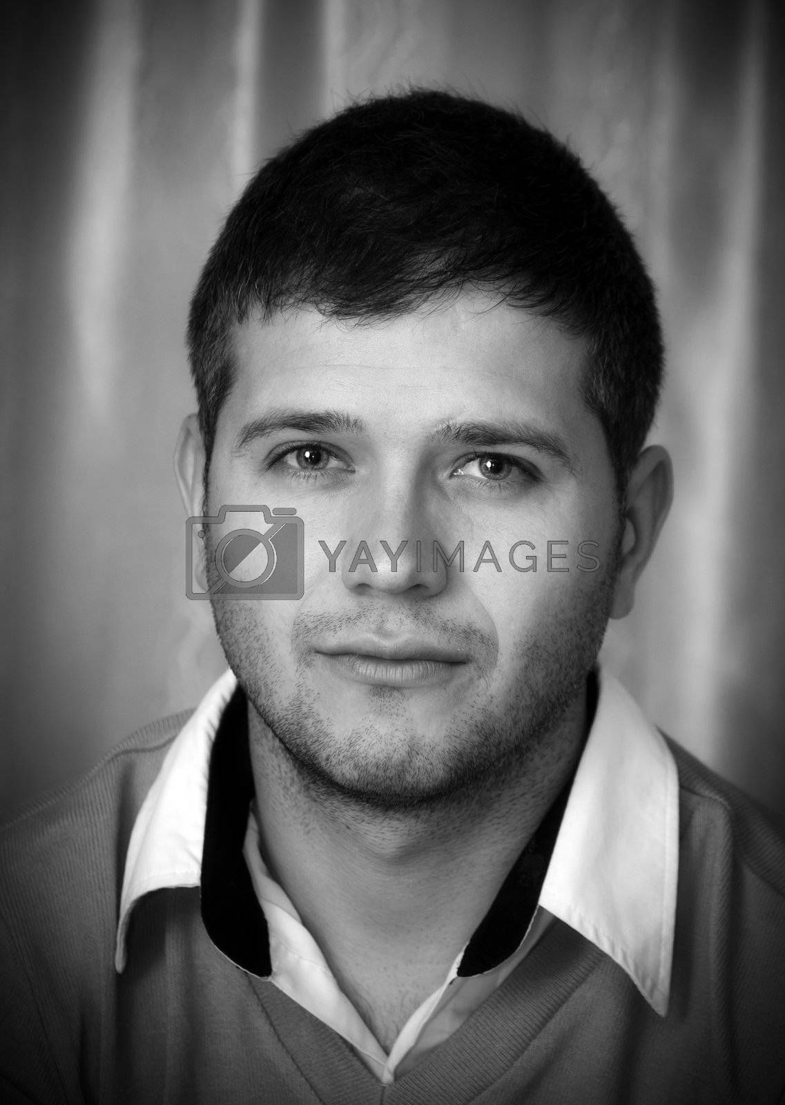 Black and white portrait of young man looking at camera