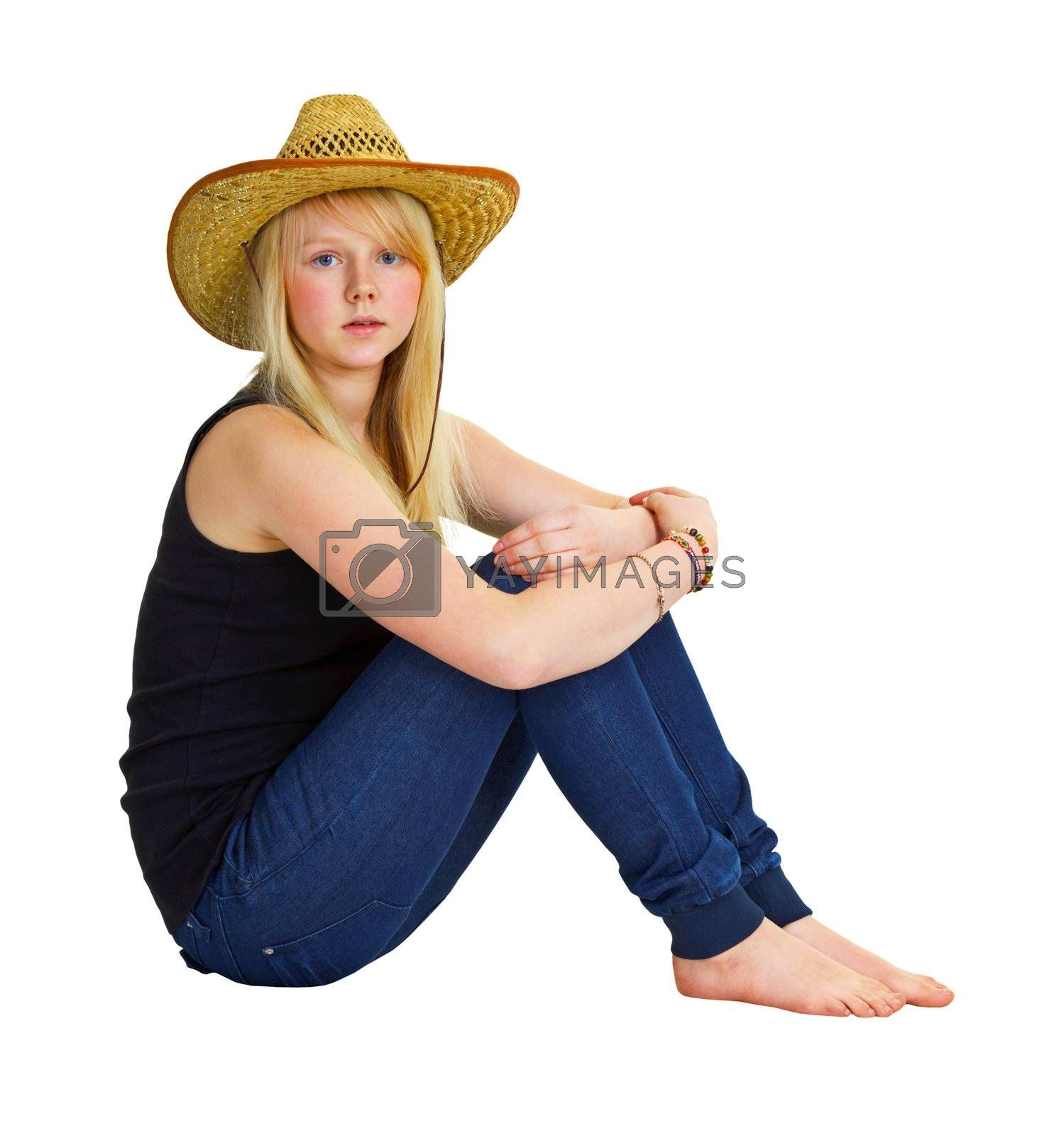 A young girl in a farmer dress sitting isolated on white background