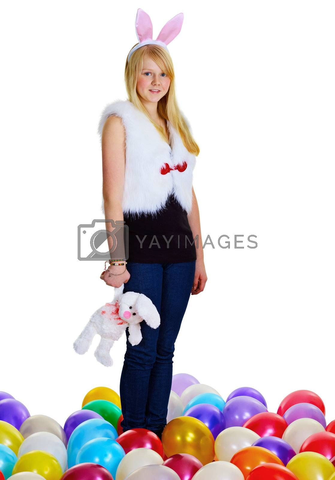 A young woman with a toy rabbit isolated on white background
