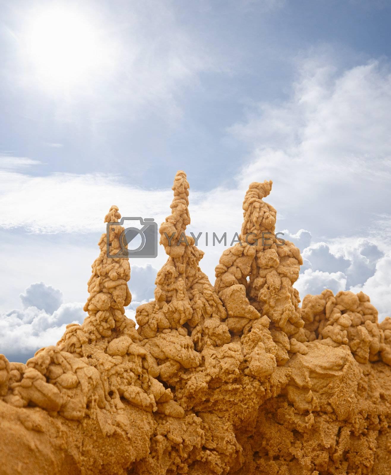 Bizarre sand castles on the sky background