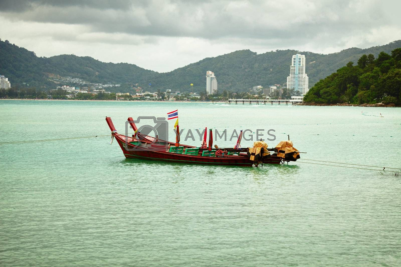 Thai longtail boats in the bay near Patong. Thailand