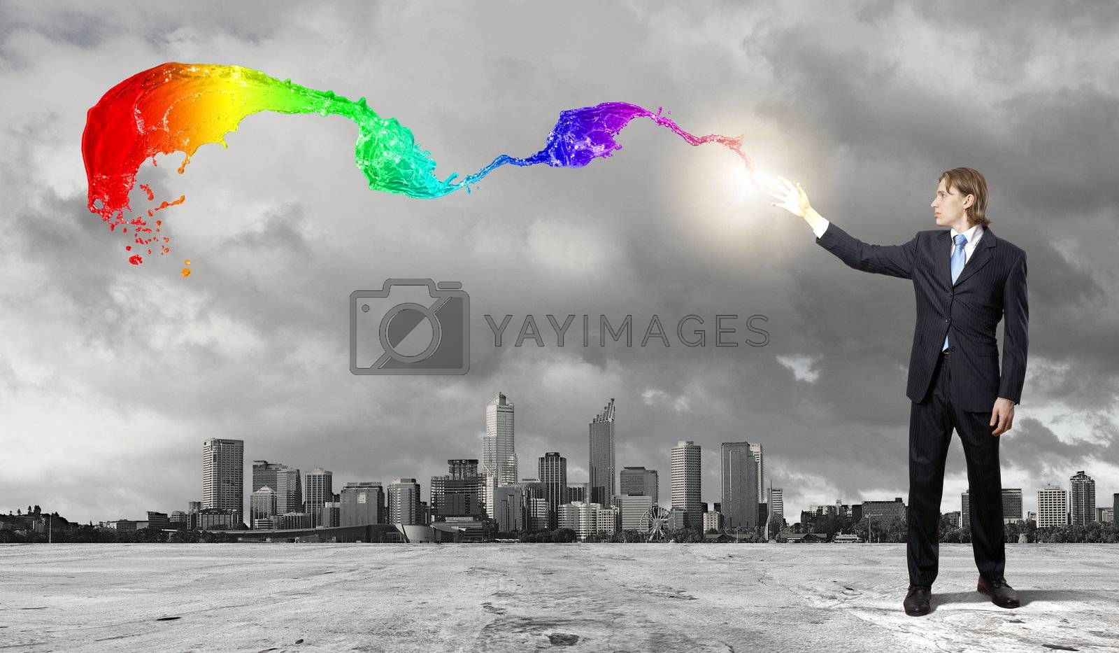 Image of a business man standing against cityscape