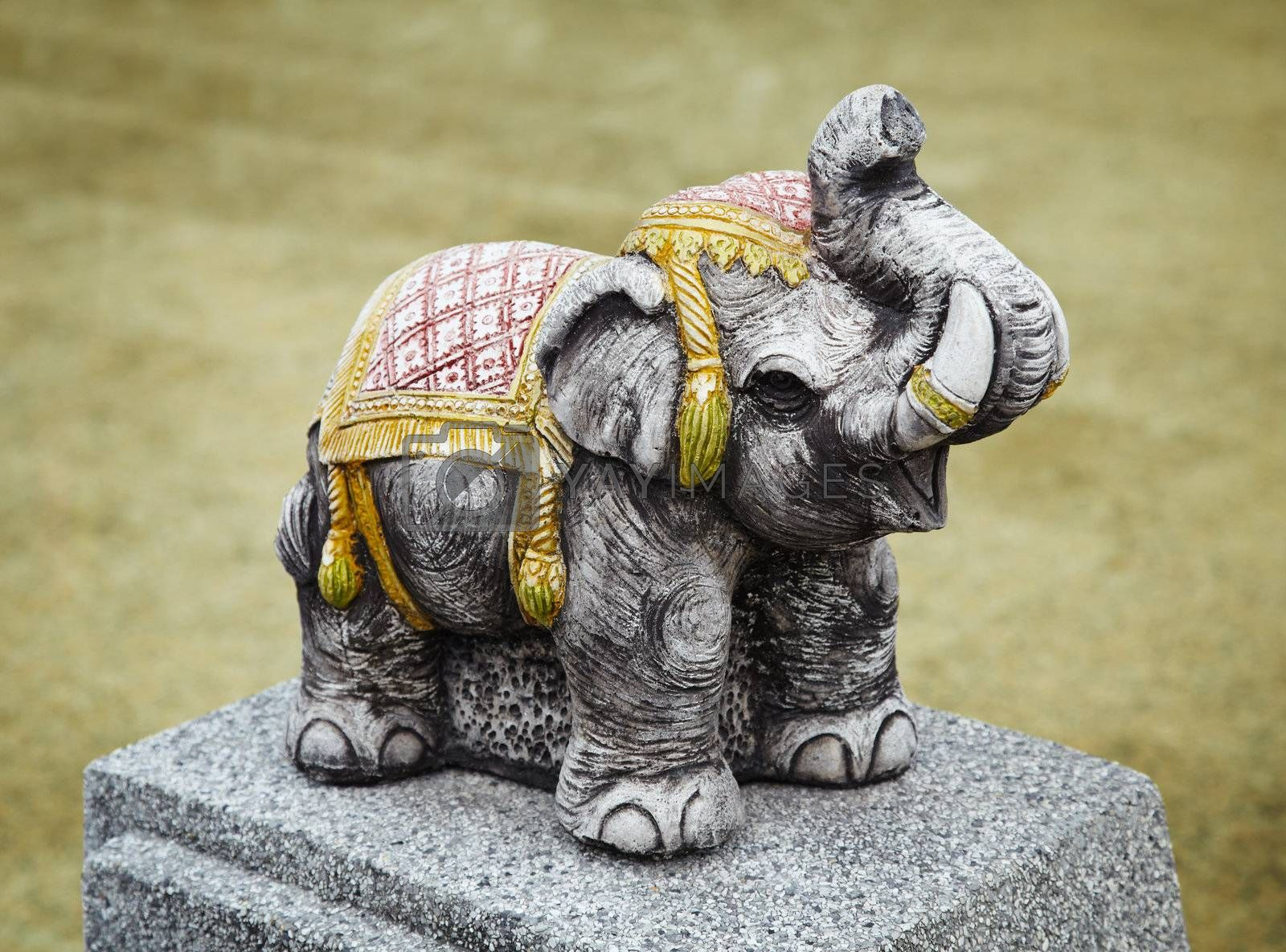 The concrete sculpture of an old Indian elephant