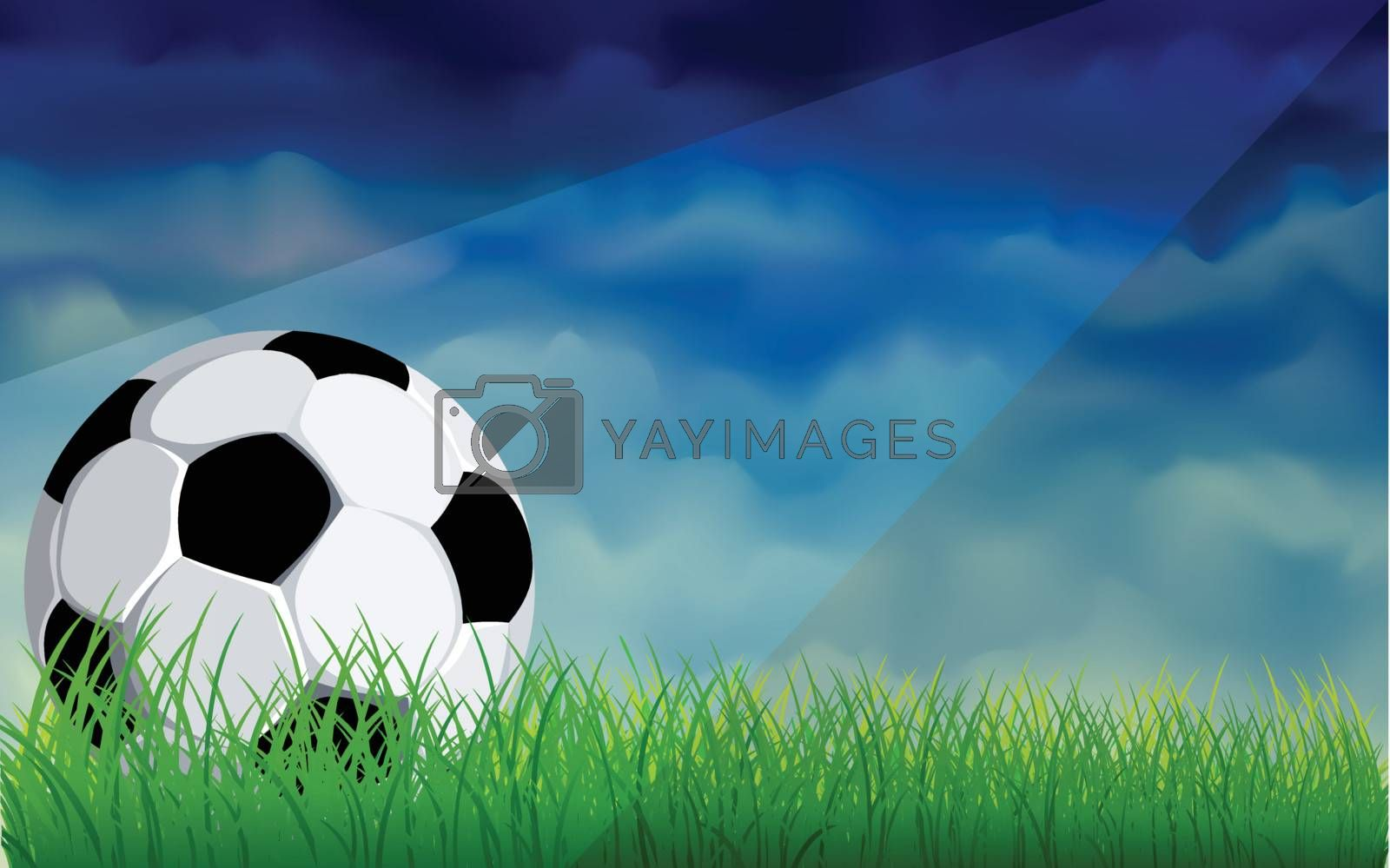 Football or soccer ball on a green lawn with dark sky