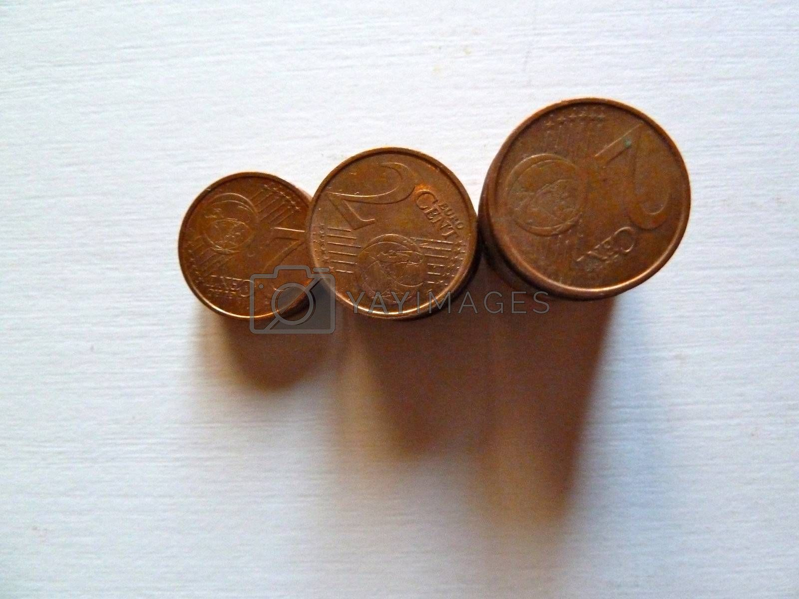 stack of brass coins on a white background