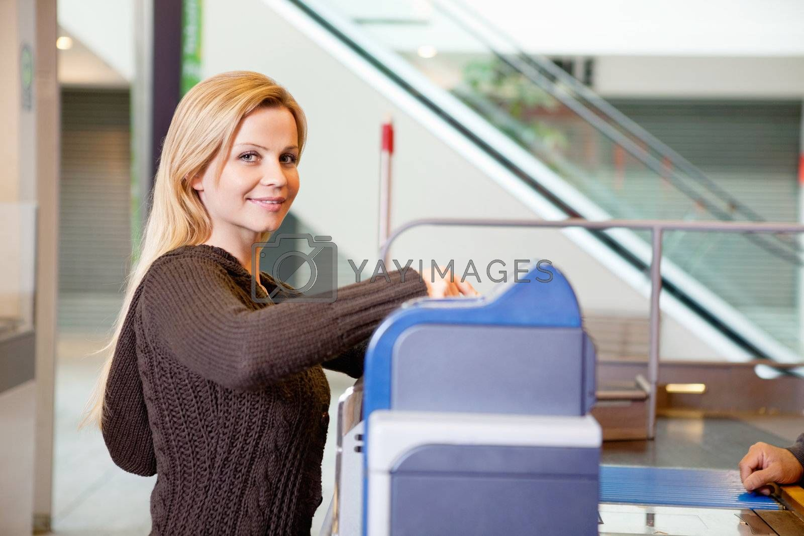 Portrait of a young woman smiling after shopping at supermarket