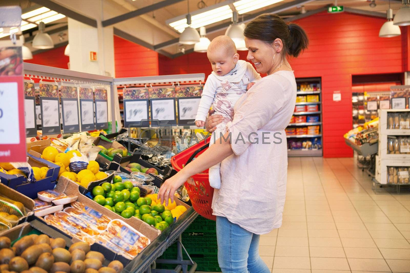 Mother and child shopping in supermarket