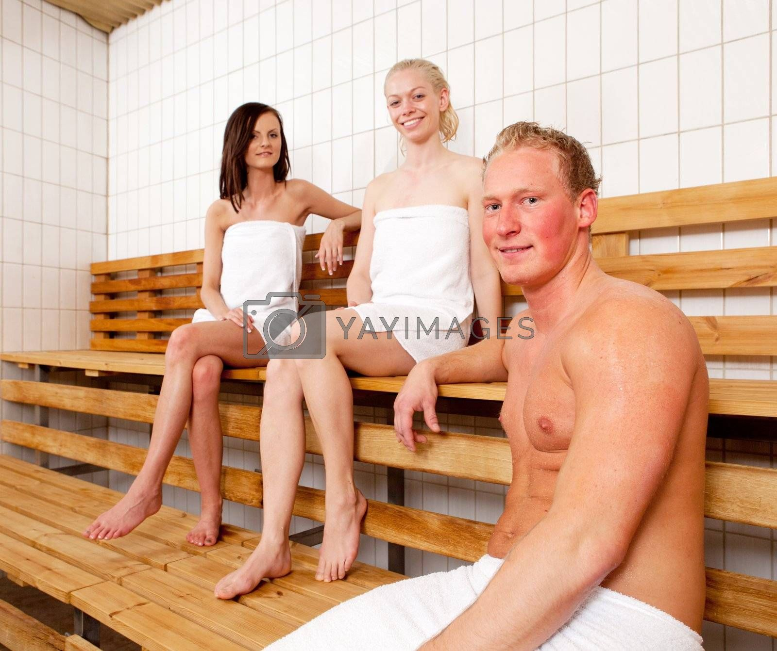Portrait of a group of friends relaxing in a sauna