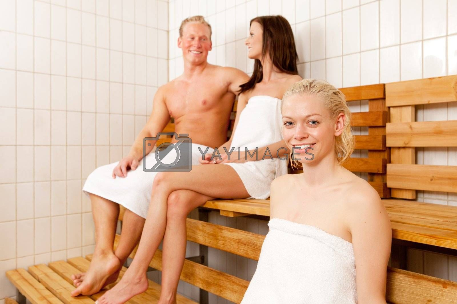 Portrait of a woman with friends in a sauna