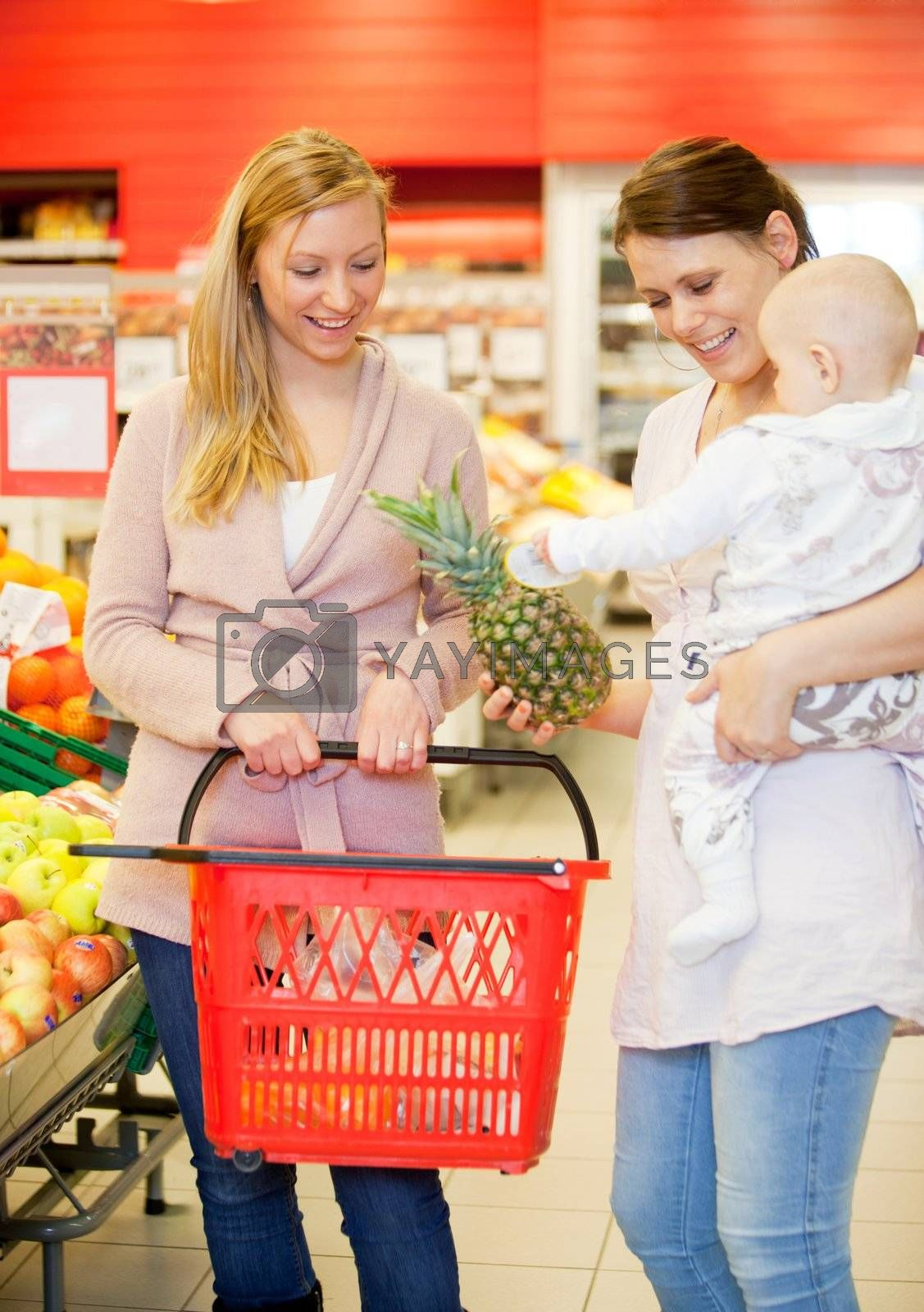 Two friends buying groceries, one with a child