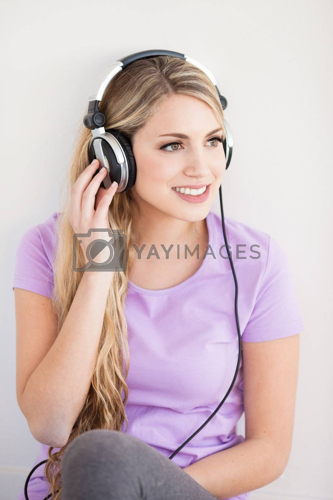 young beautiful woman listen music with headphones isolated