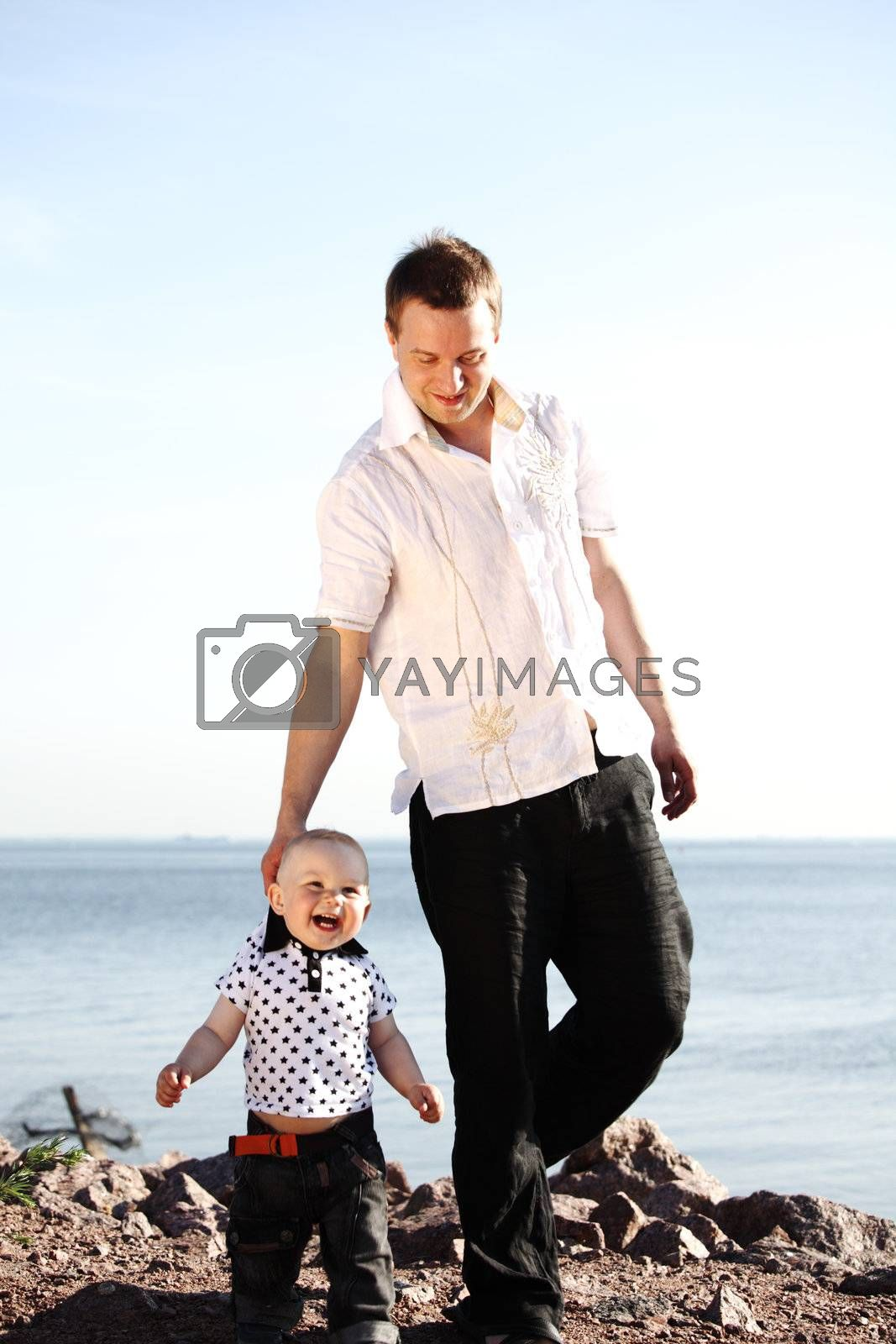 father and son walking on grass