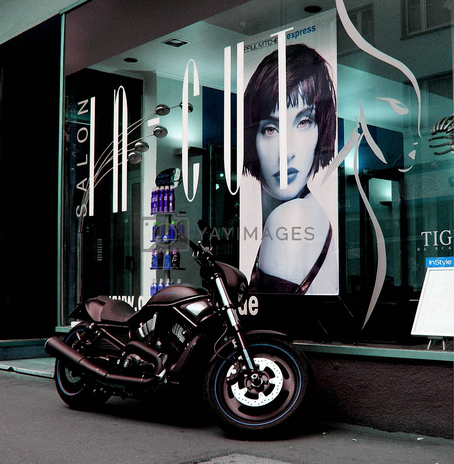 Shopping street in downtown Mainz with a motorcycle at a shop window.