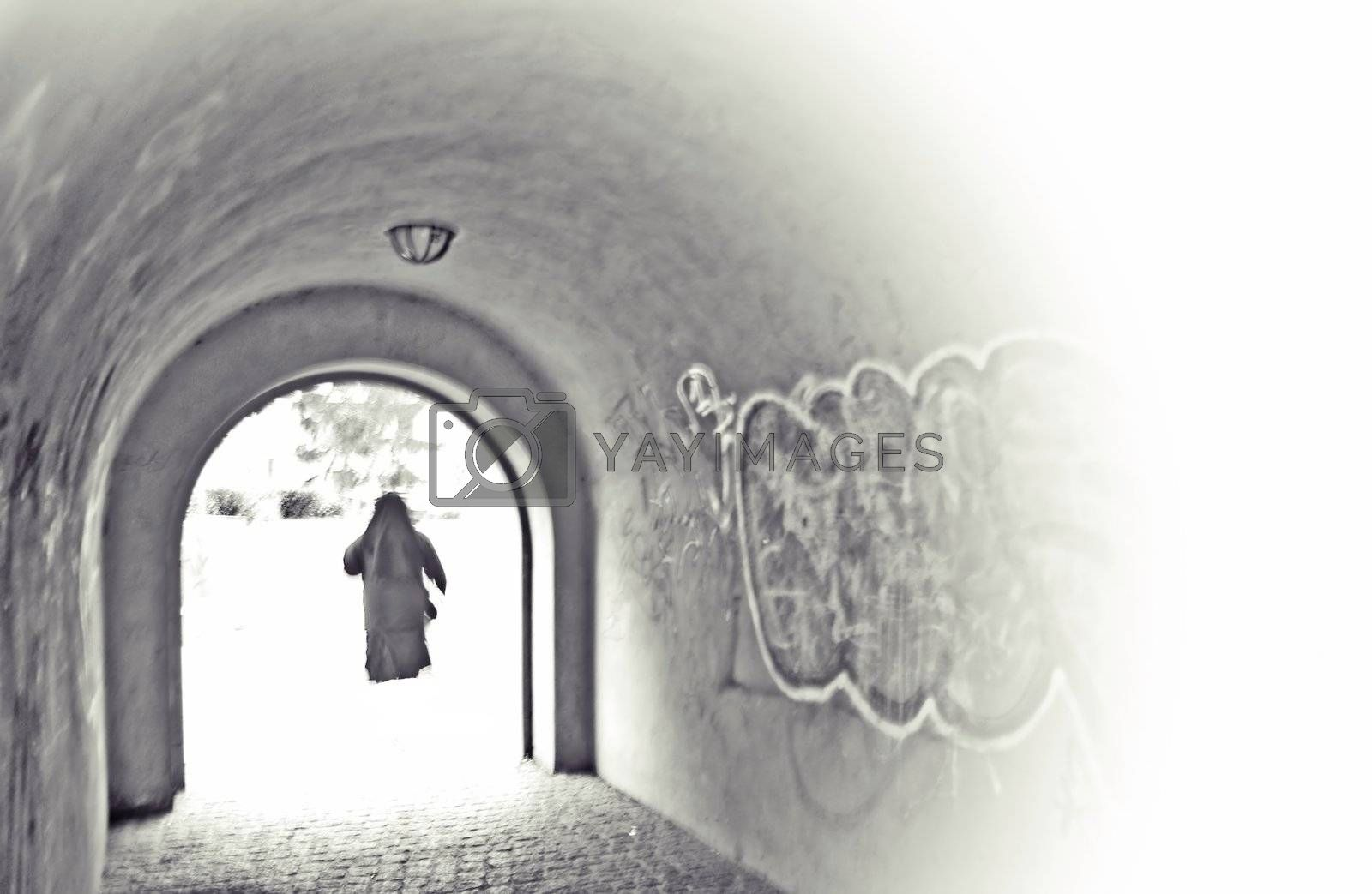 A nun passes through a tunnel and go right into the light.