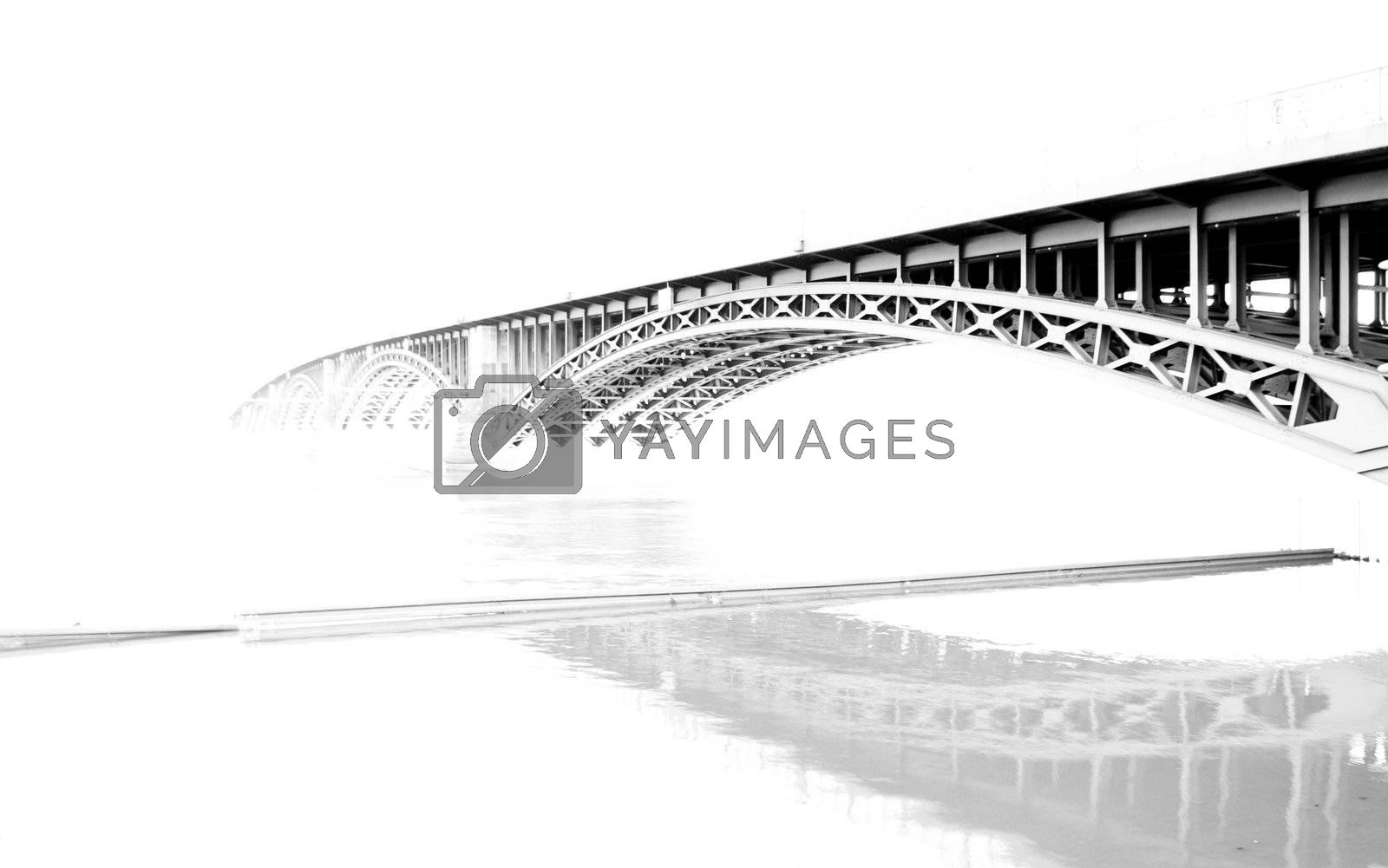 A bridge photographed with a long exposure. High key.