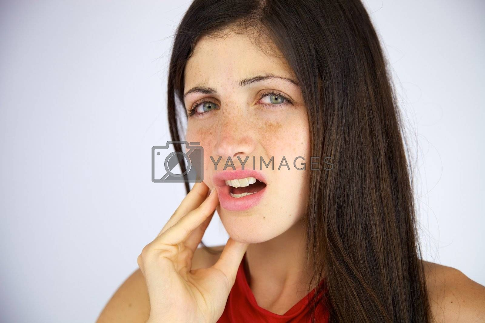 Gorgeous female model suffering bad toothache closeup