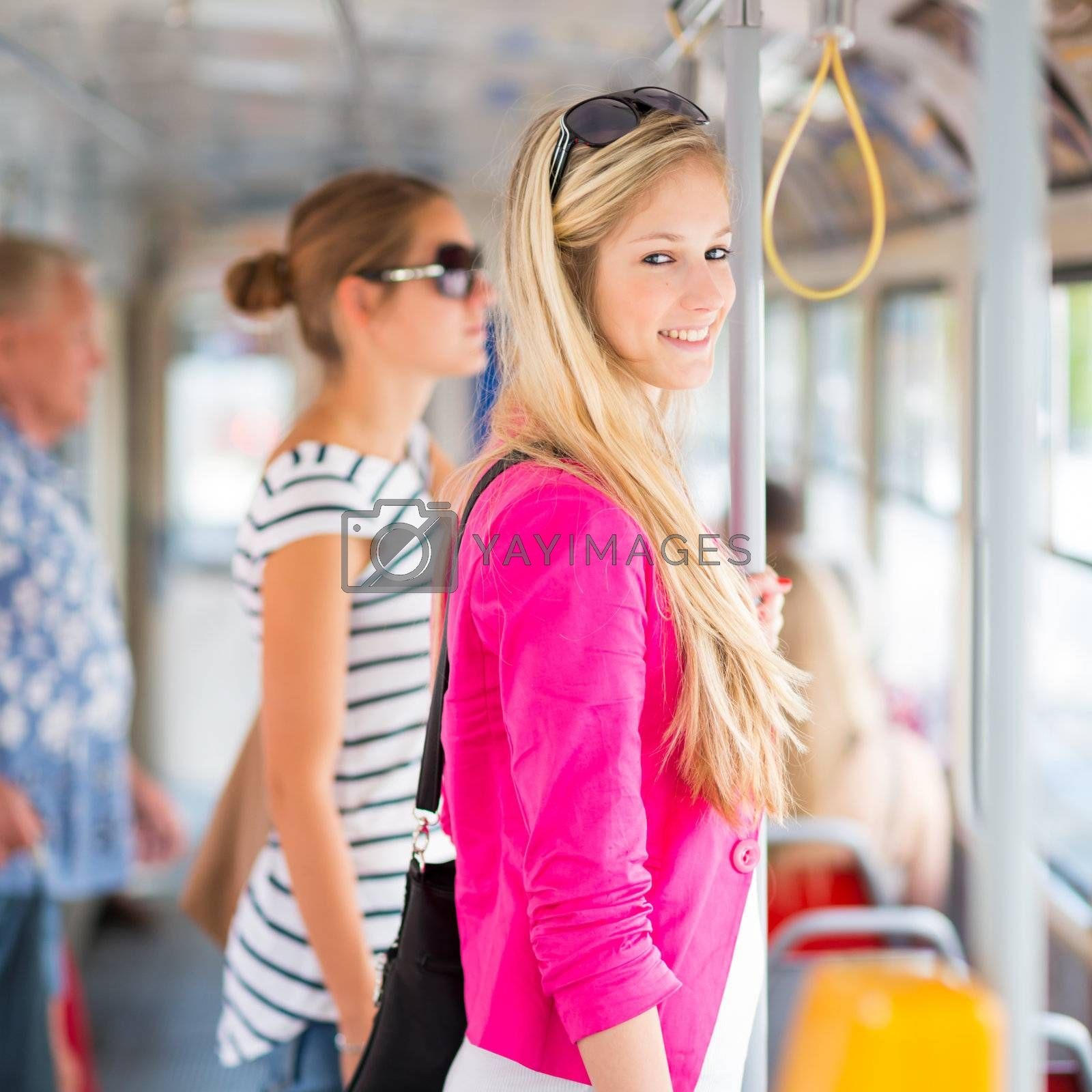 Pretty, young woman on a streetcar/tramway by Viktor Cap
