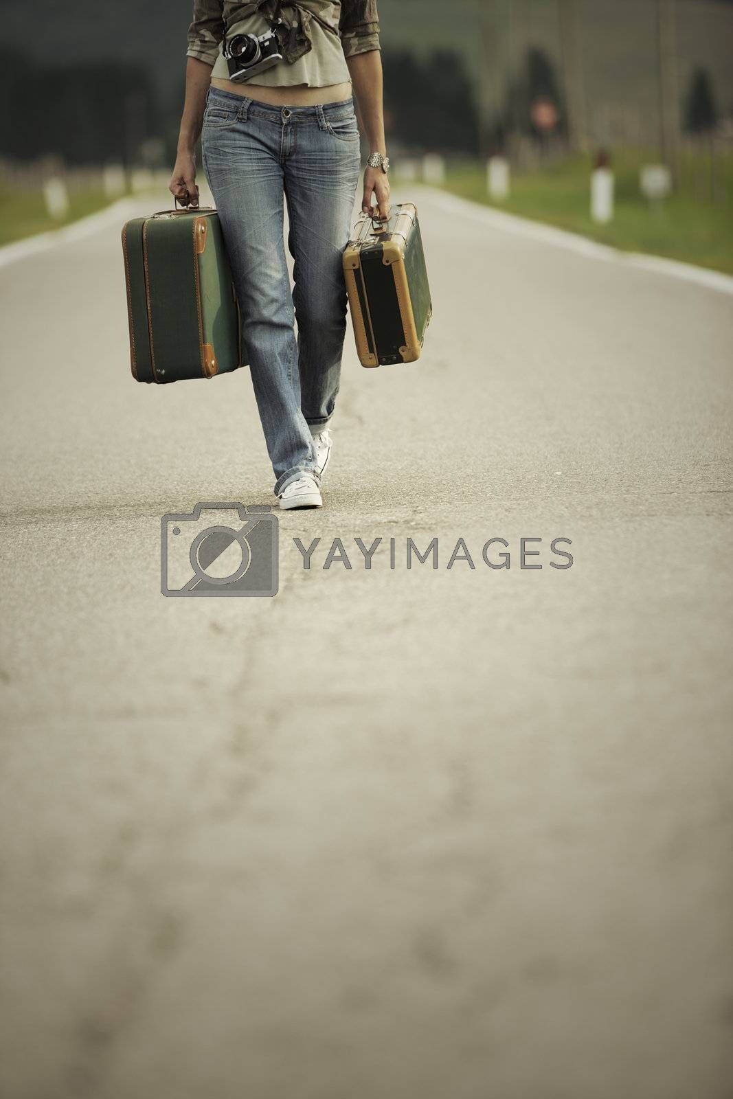 Young woman runaway walks away road. Copy space