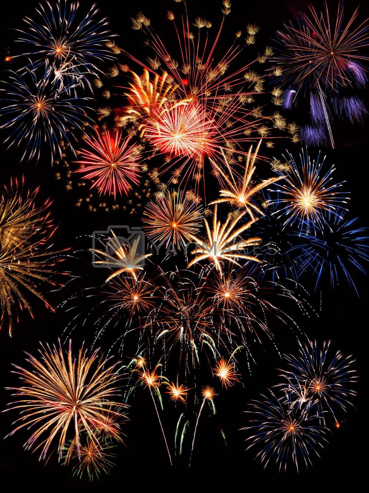 Majestic colorful holiday fireworks on the black sky background,  long exposure