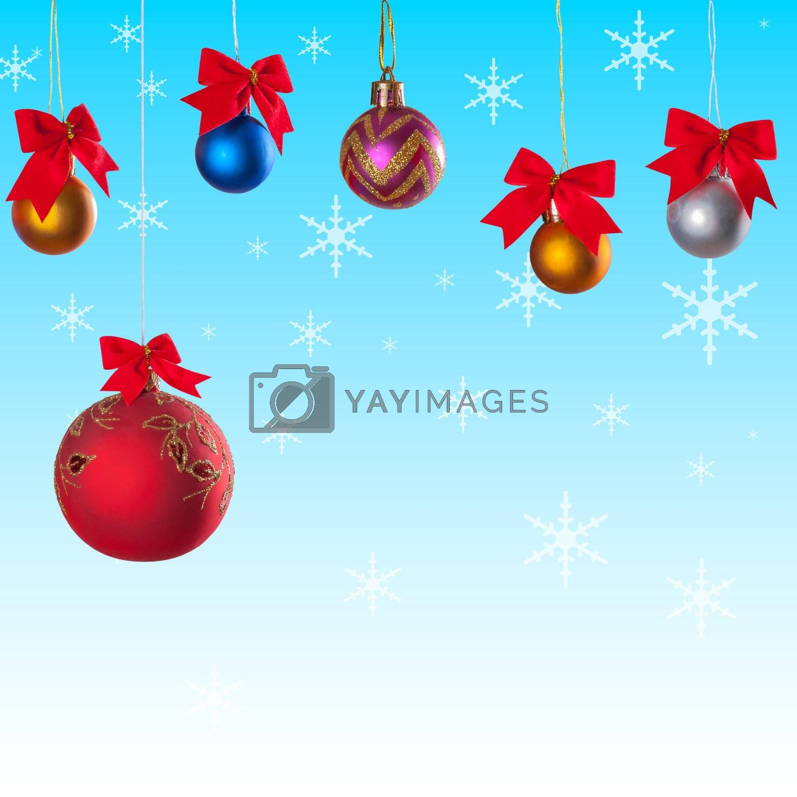 Winter background with christmas balls on ribbon and snow on festive background