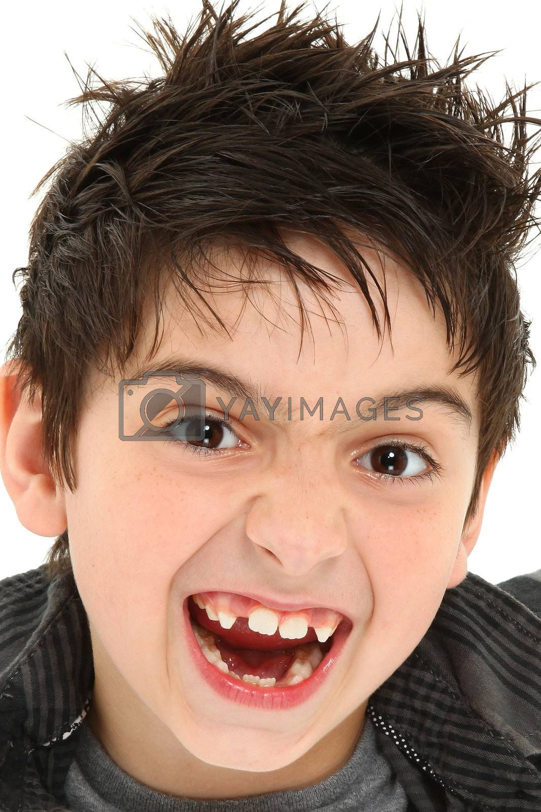 Hilarious 8 year old boy making crazy face up close.