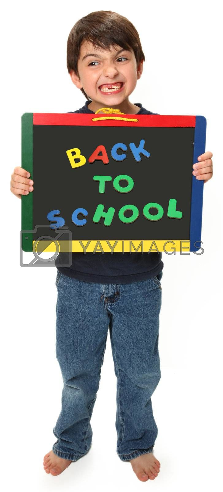 adorable seven year old boy holding back to school magnetic chalk board making silly face