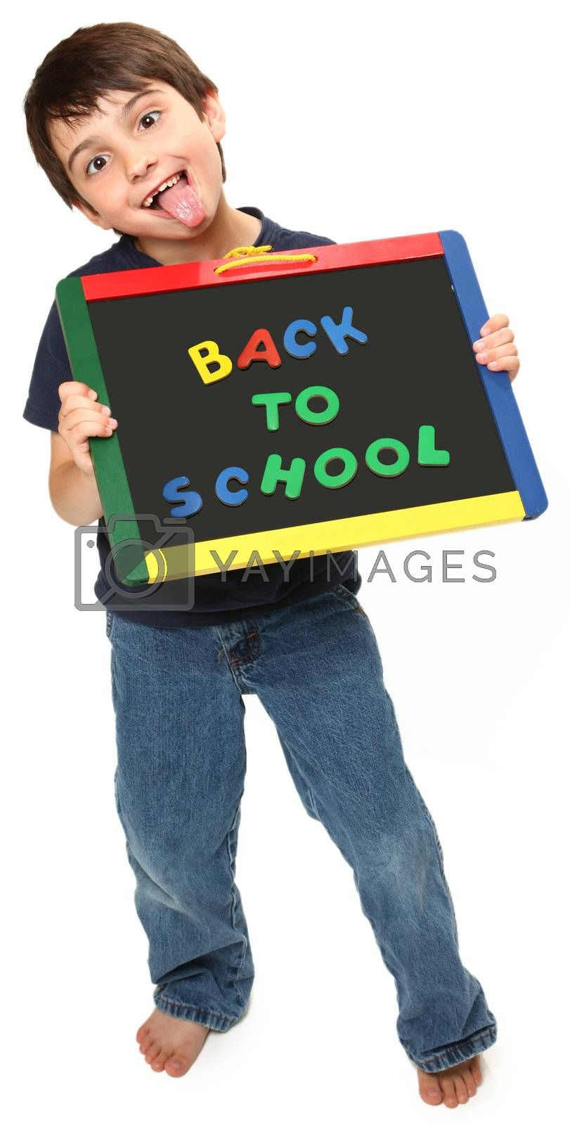 adorable seven year old boy holding back to school magnetic chalk board making silly faces
