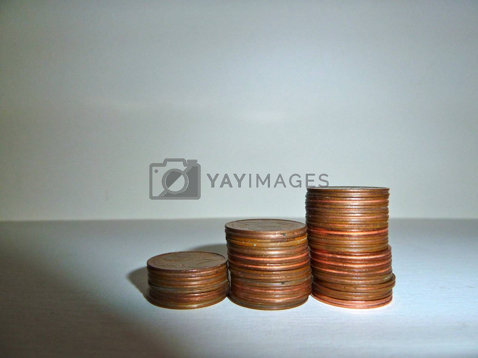stack of coins on white with shadows
