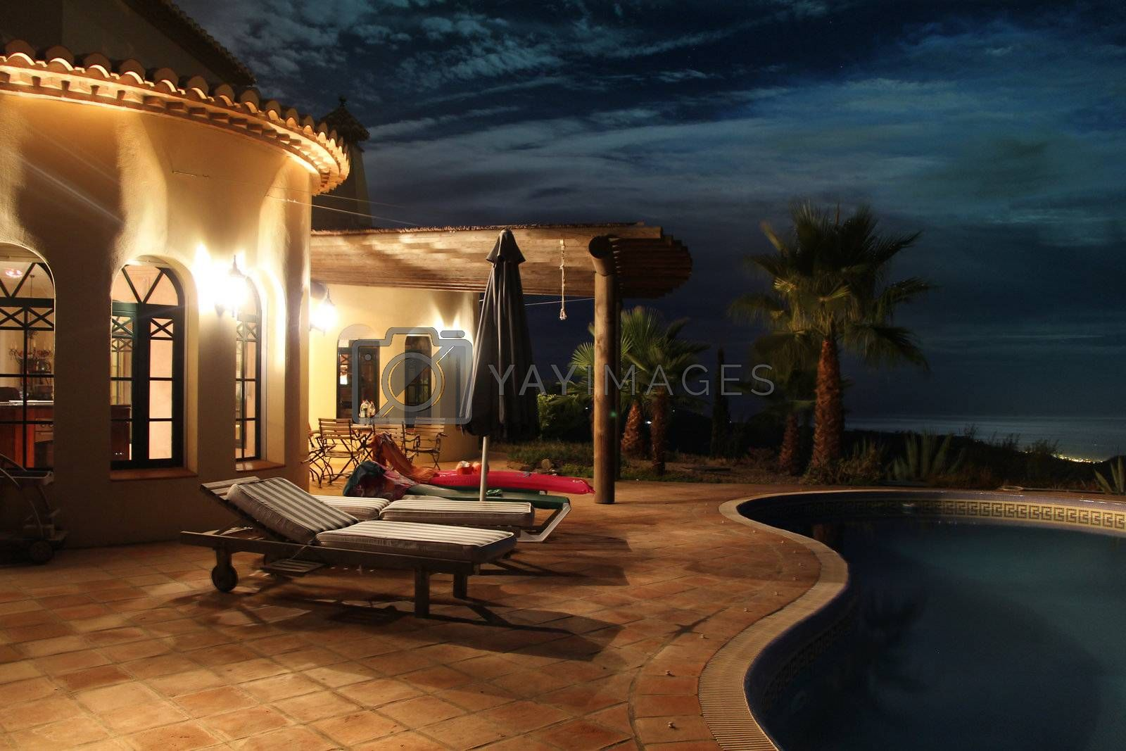 south sea facade with nice lights, palms and pool