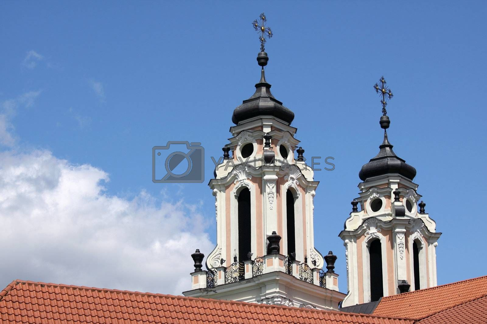 Two baroque church towers against clear blue sky in Vilnius, capital of Lithuania