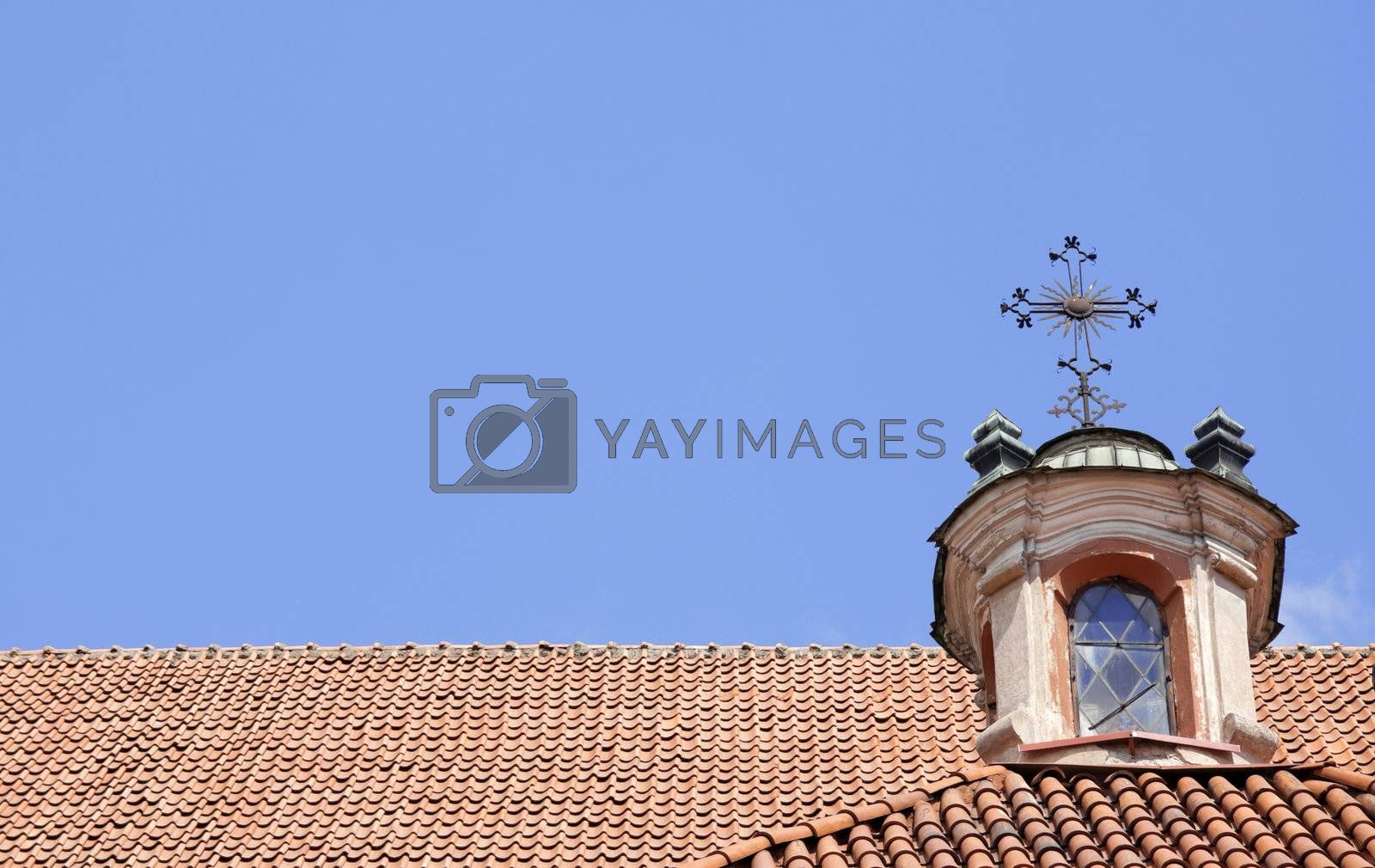 Architectural detail of christian church roof with plenty of copy space on blue sky