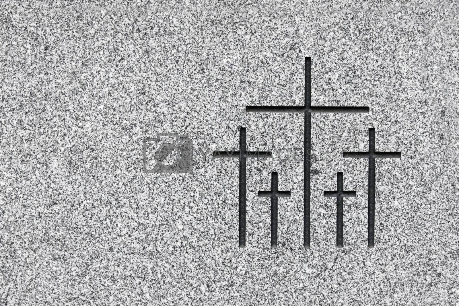 Black and white picture of the group of crosses carved on grey stone. Plenty of space on the left to add text