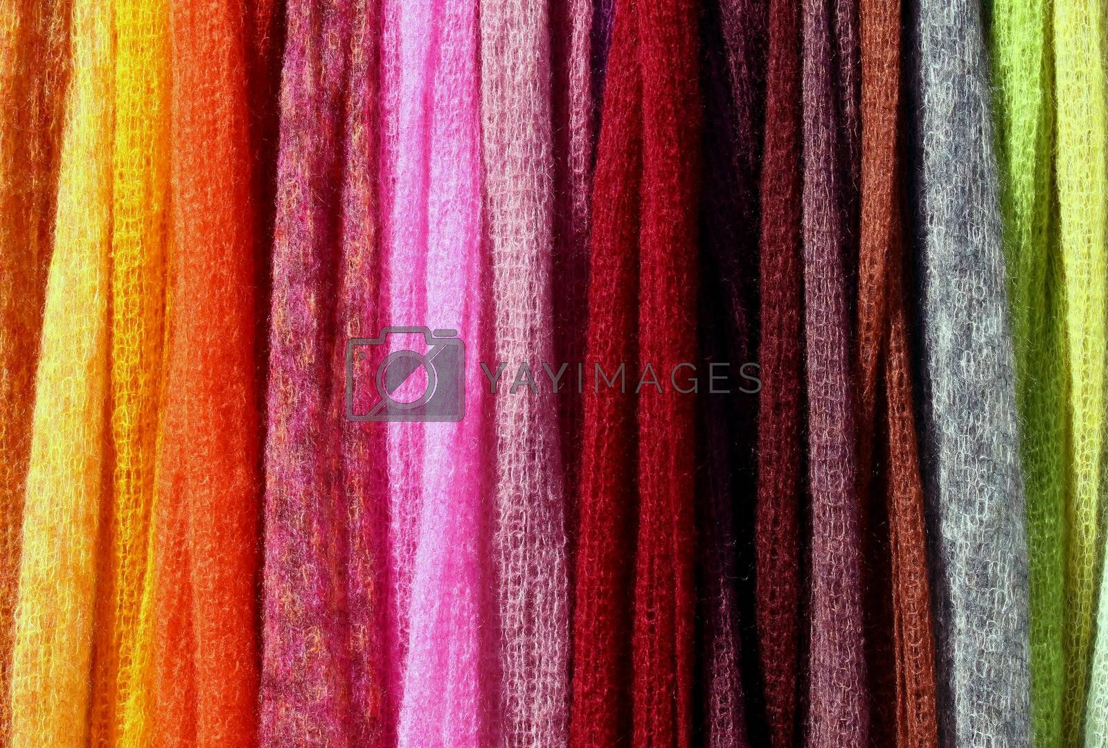 Multicolored knitted blankets, perfect stripes background