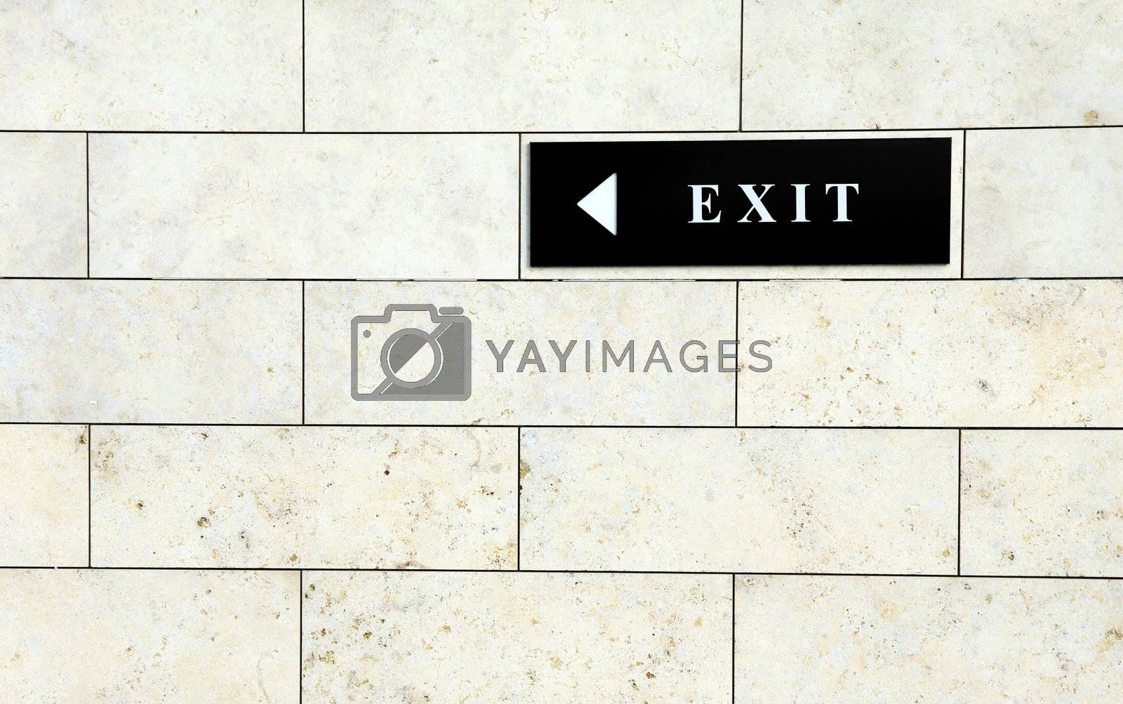 Black exit sign on the white wall