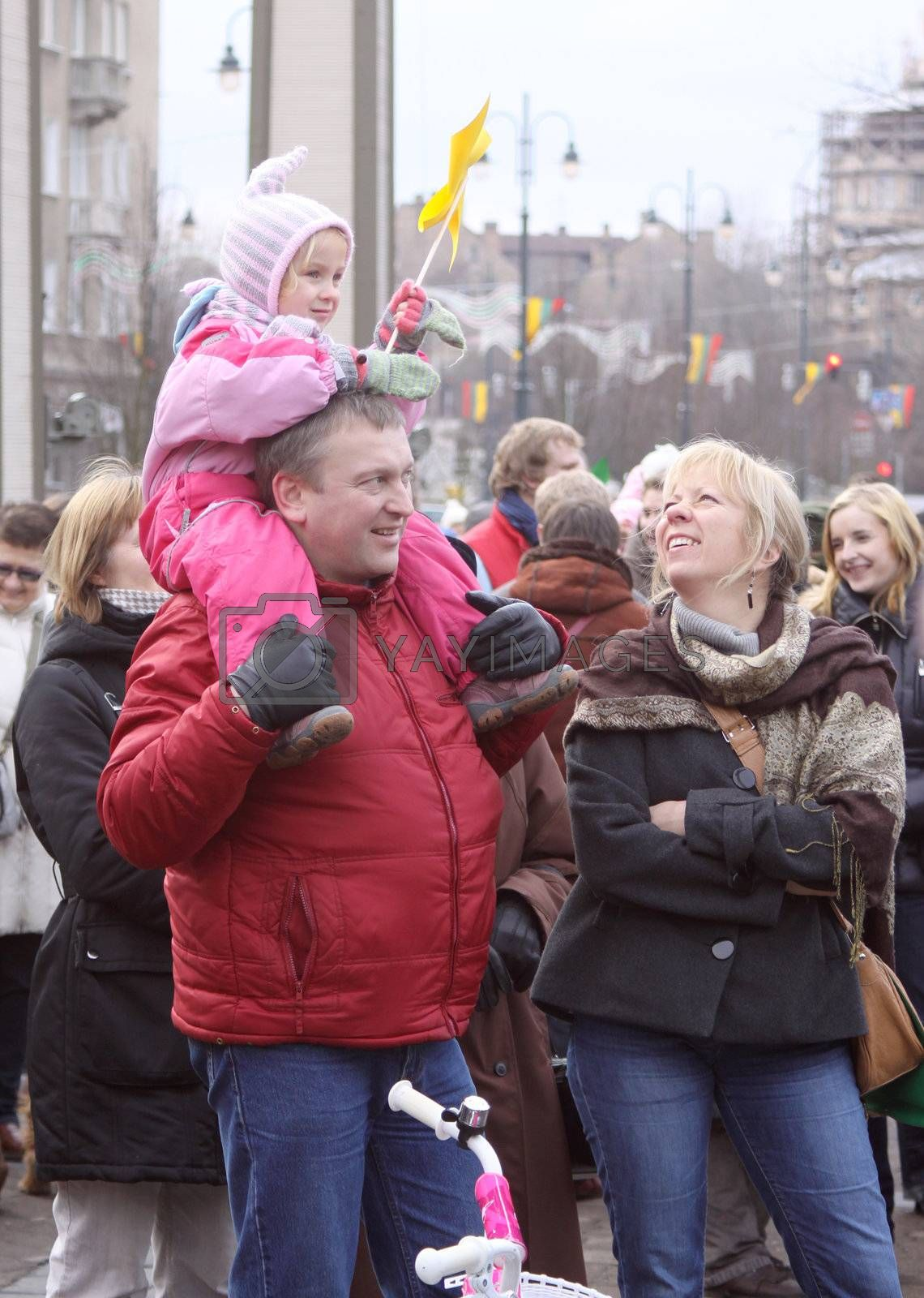 Happy family at the Lithuanian independence day celebration in Vilnius on 11th of March