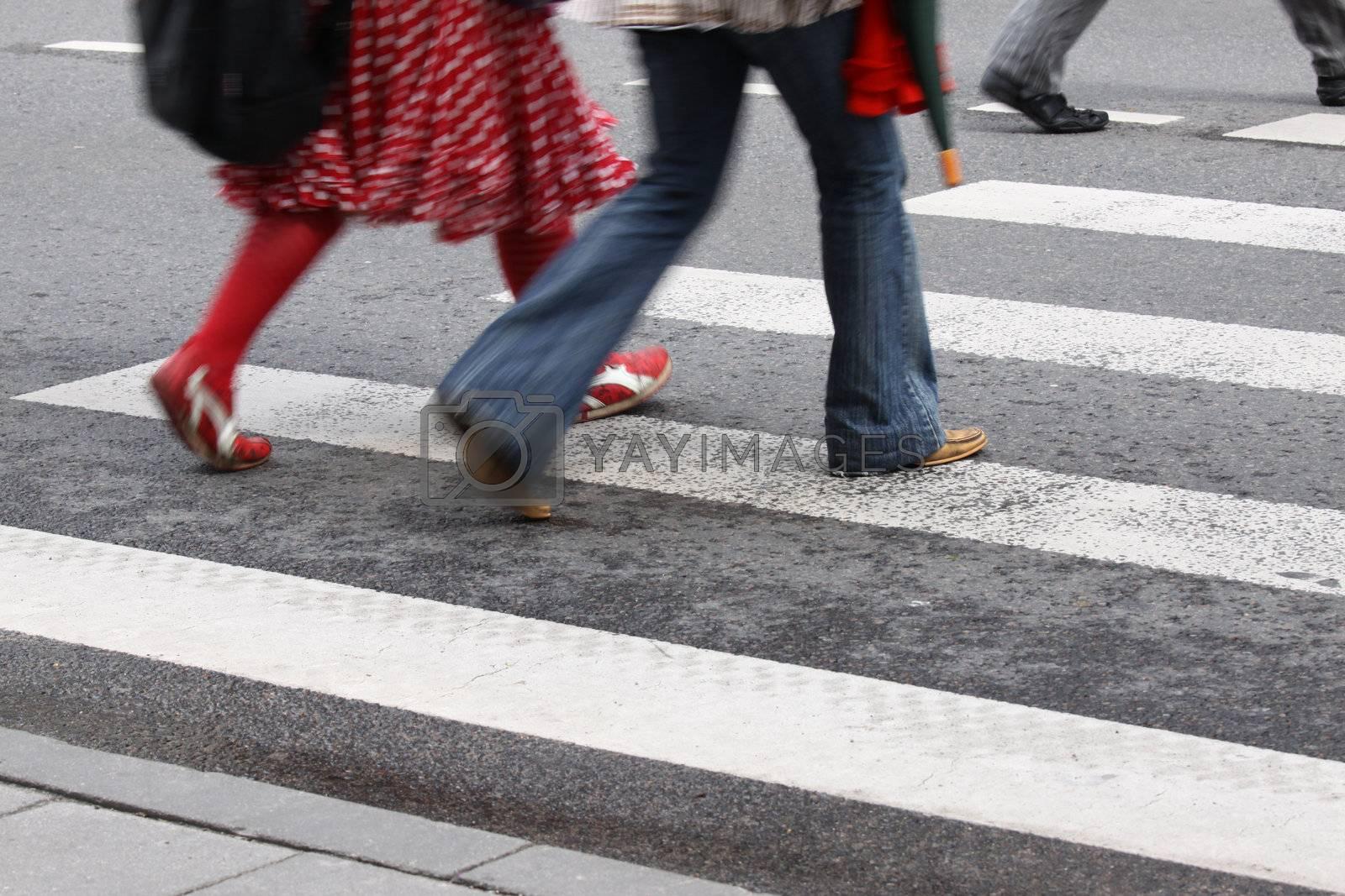 Horizontal picture of blurred pedestrians crossing crosswalk