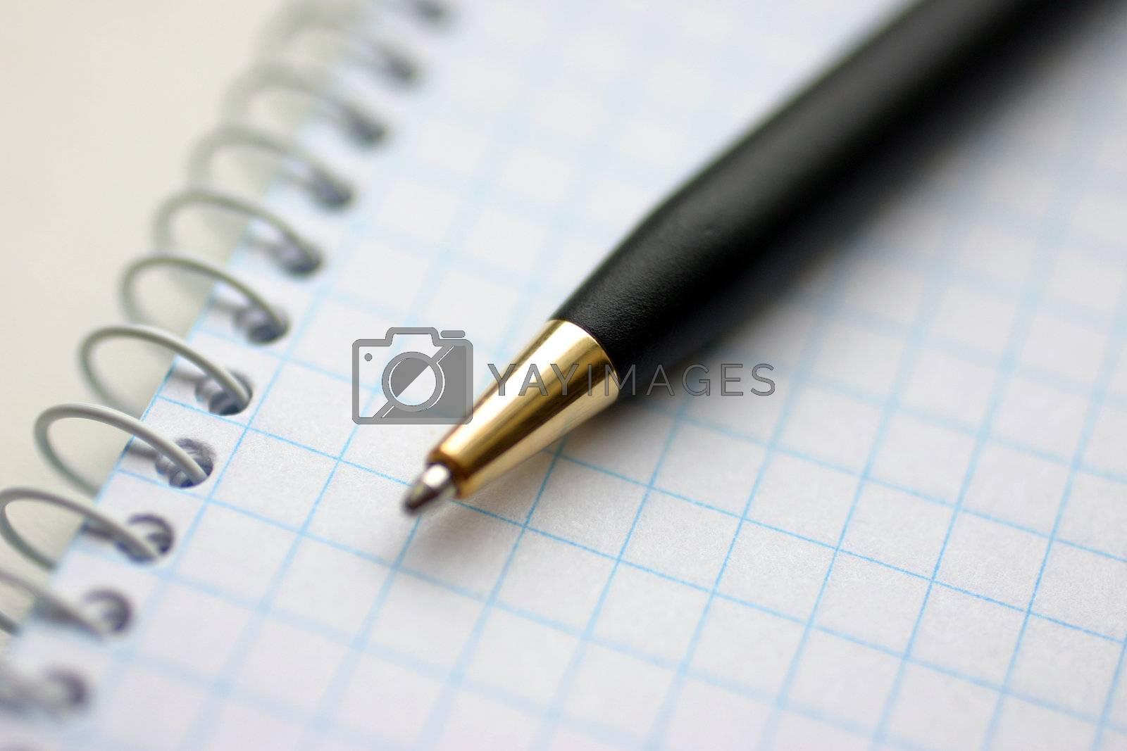 Spiral checkered white handbook and pen closeup