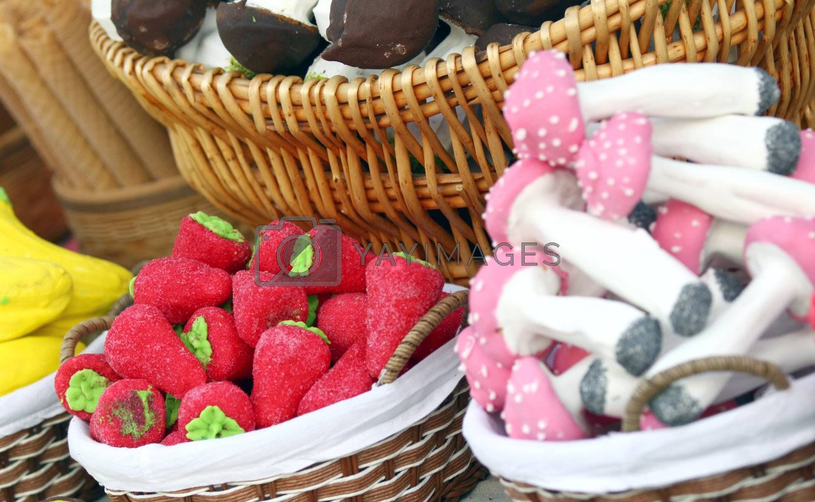 Close up of various colorful handmade sweets served in baskets
