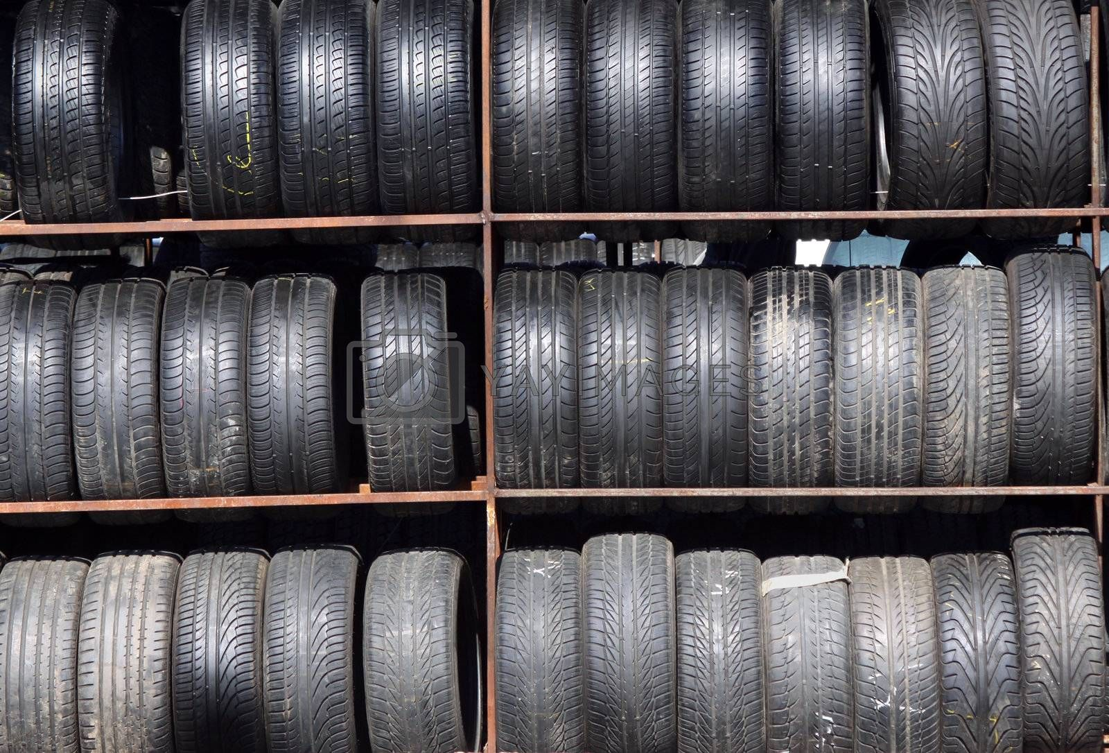 Old car tyres stacked on the rack
