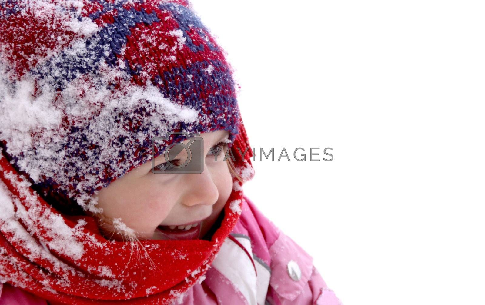 Cheerful little girl at winter, plenty of copy space