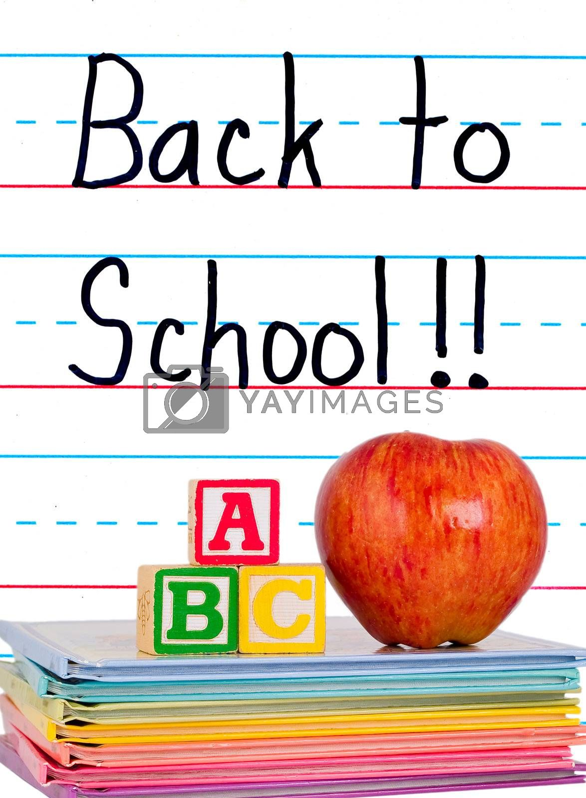Back to School Written on a Lined Dry Erase Board with Books