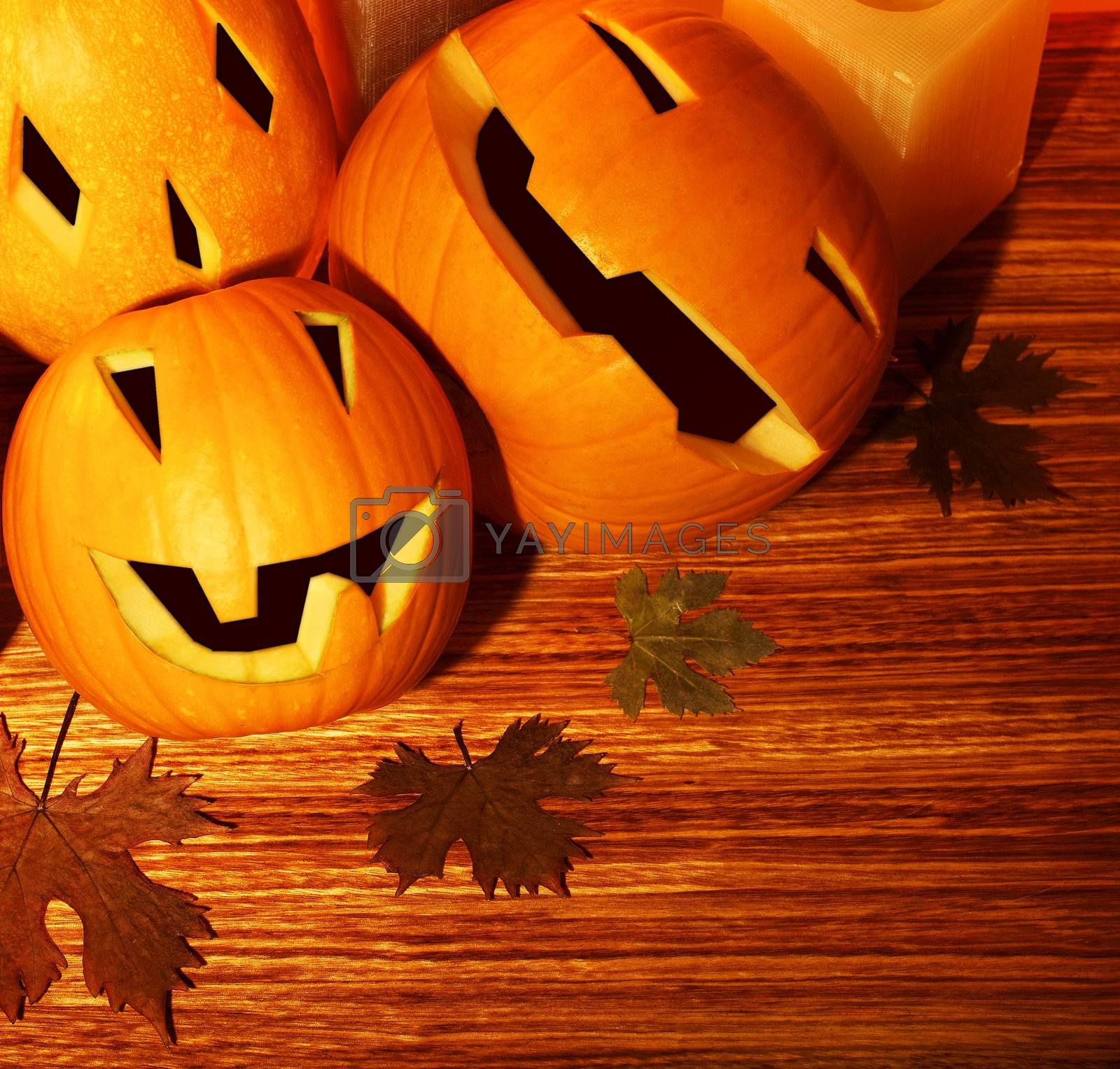 Halloween pumpkins holiday border, autumn wooden background, traditional jack-o-lantern over wood with dry leaves, night party decoration