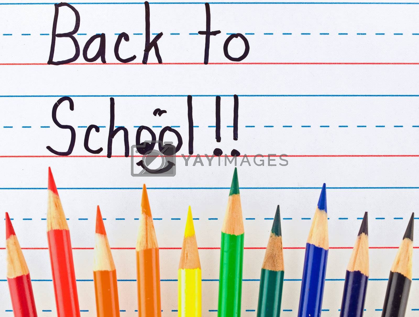 Back to School Written on a Lined Dry Erase Board with Colored Pencils