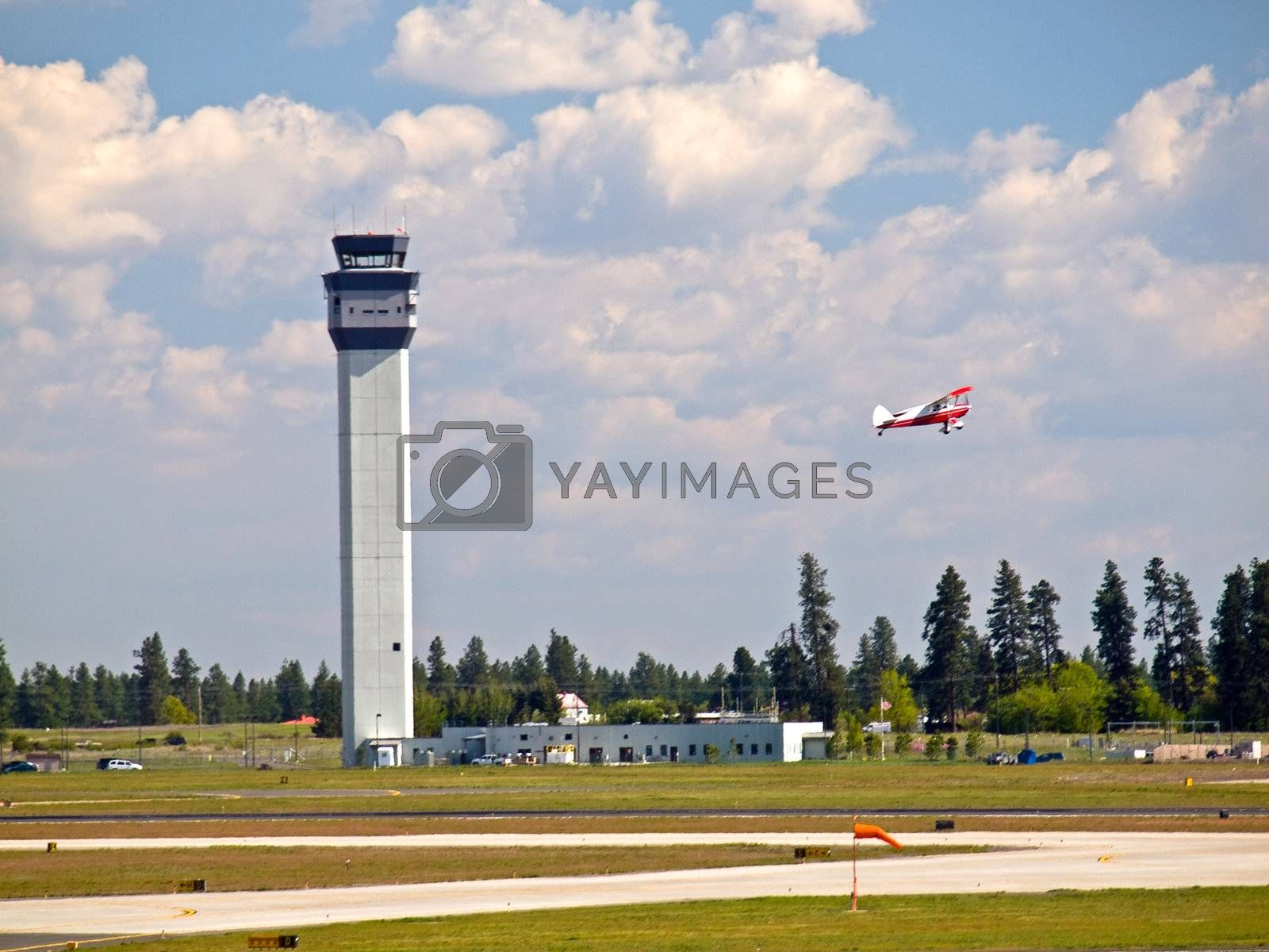 Air Traffic Control Tower of a Modern Airport with Aircraft Taking Off
