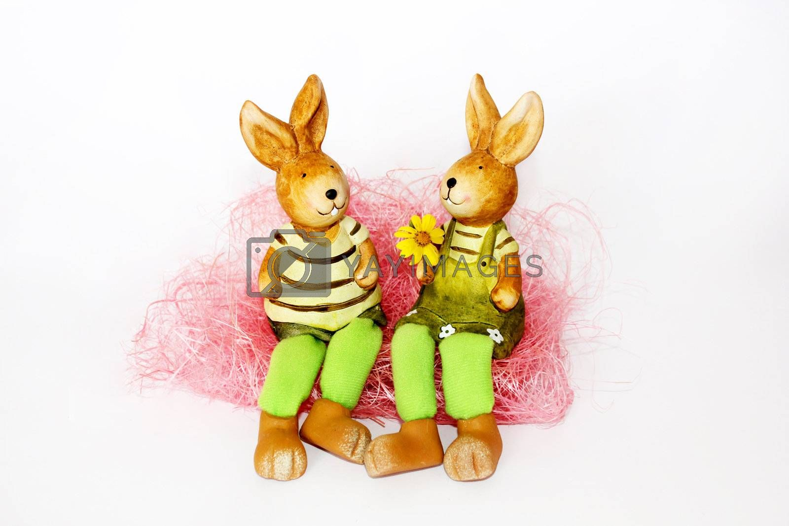 toy Easter rabbits on white background