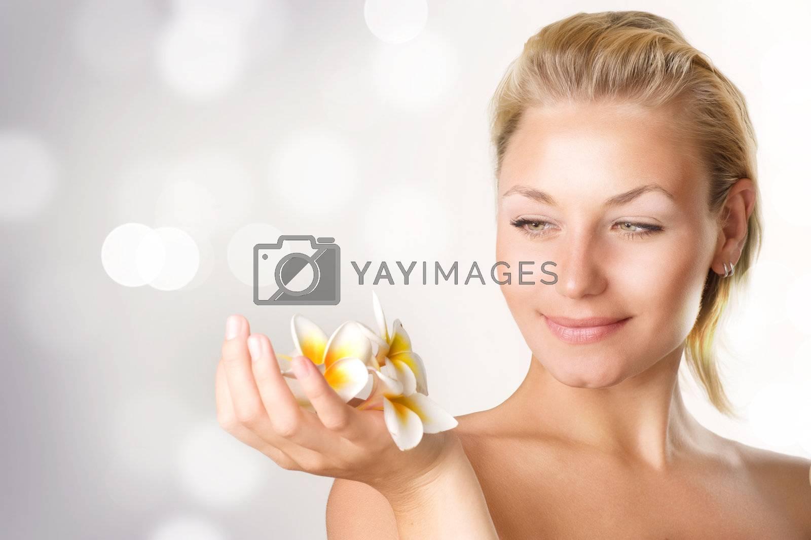 Beautiful Spa Girl with Frangipani flowers