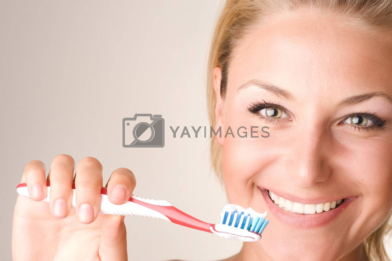 Happy Young Woman Brushing Her Teeth